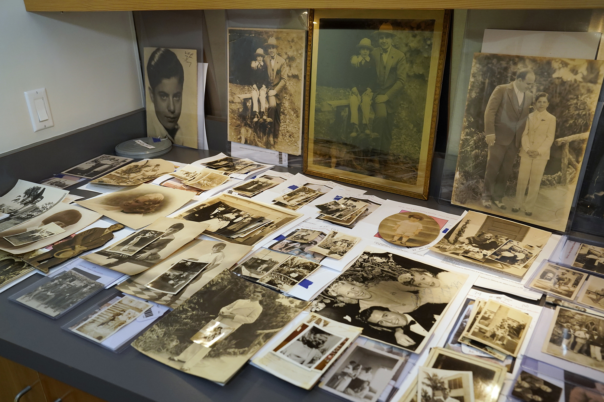 A collection of photographs from the estate of mob boss Al Capone is displayed at Witherell's Auction House in Sacramento, California.
