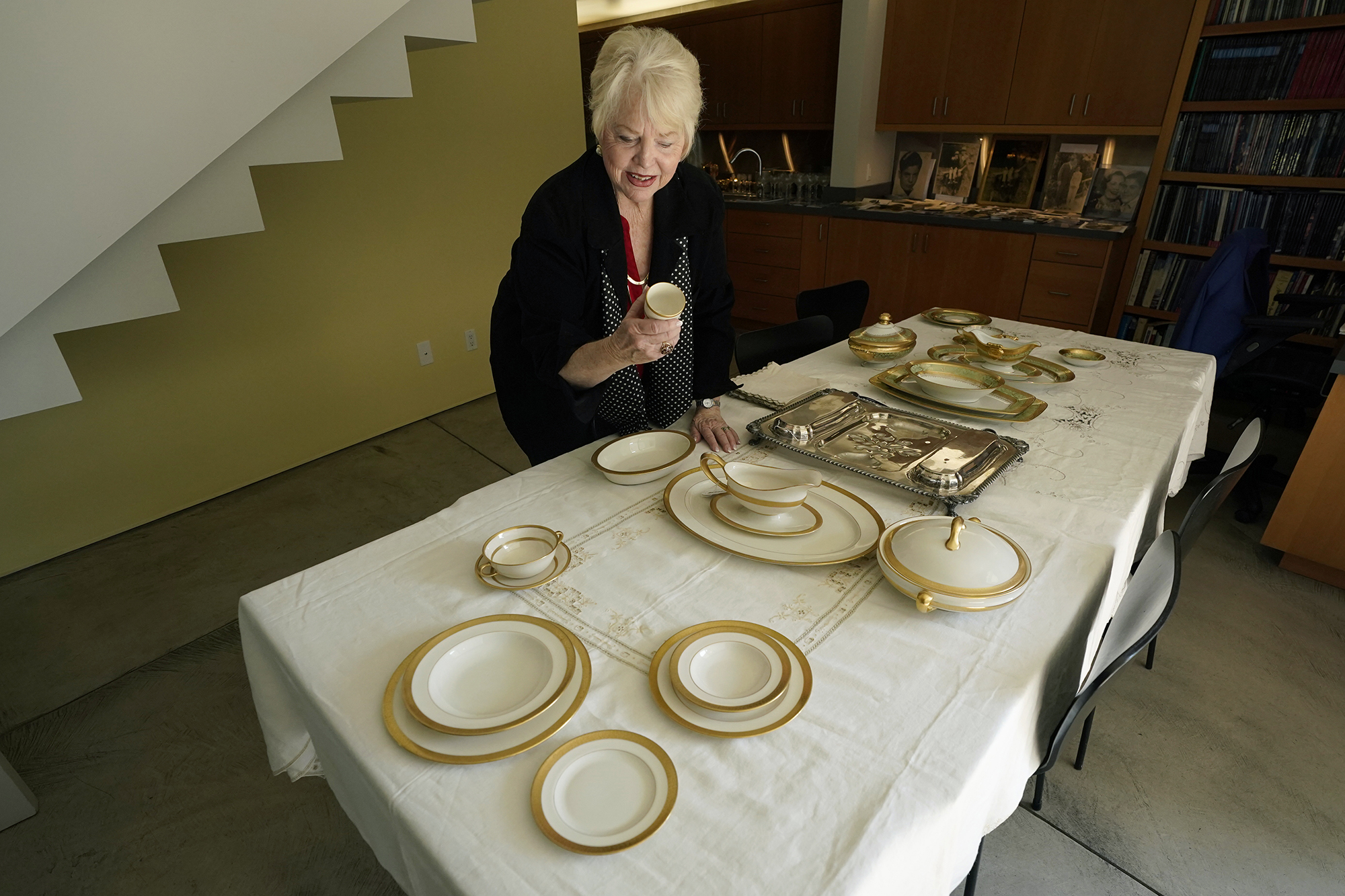 Diane Capone examines a china set that once belonged to her grandparents, Mae and Al Capone.