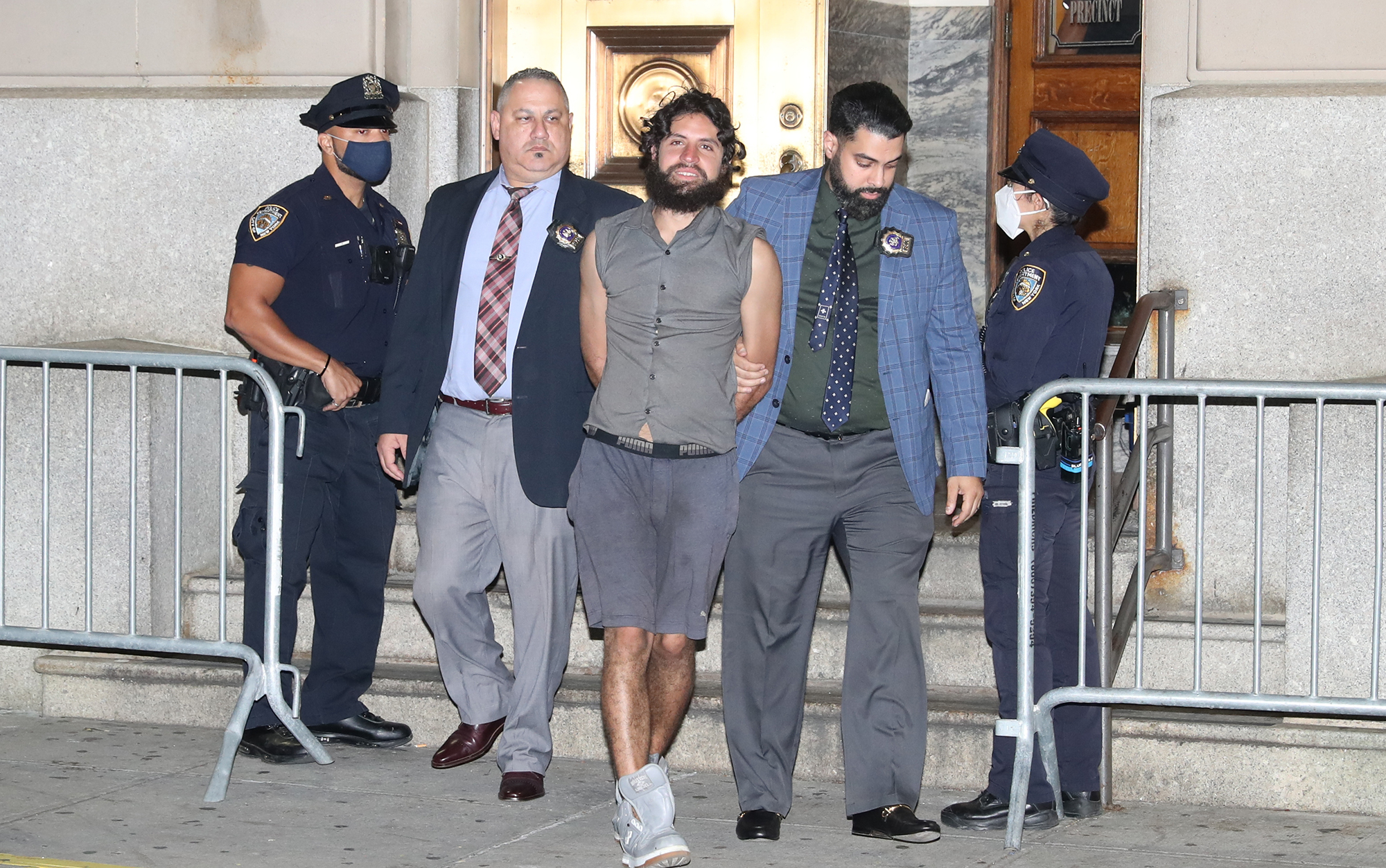 Santiago Salgado is walked from the 45th Precinct in the Bronx. He attempted to kidnap a young girl.